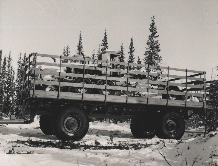 Sno-Freighter Hauling Two Scrapers